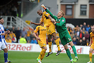 Chris Zebroski of Newport County is beaten to the ball by Steve Mildenhall the Bristol Rovers goalie. Skybet League two match, Newport county v Bristol Rovers at Rodney Parade in Newport, South Wales on Saturday 17th August 2013. :  pic by Phil Rees ,Andrew Orchard sports photography,