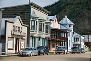 Dawson City was the center of the Klondike Gold Rush (1896–99), after which population rapidly declined, in Yukon, Canada. Dawson City shrank further during World War II after the Alaska Highway bypassed it 300 miles (480 km) to the south using Whitehorse as a hub. In 1953, Whitehorse replaced Dawson City as Yukon Territory's capital. Dawson City's population dropped to 600–900 through the 1960s-1970s, but later increased as high gold prices made modern placer mining operations profitable and tourism was promoted. In Yukon, the Klondike Highway is marked as Yukon Highway 2 to Dawson City.