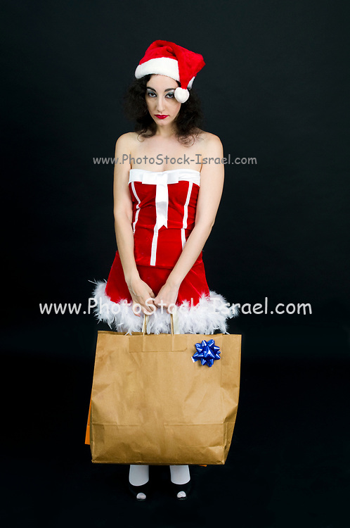 Young tired sexy woman wearing Santa hat does her Christmas shopping