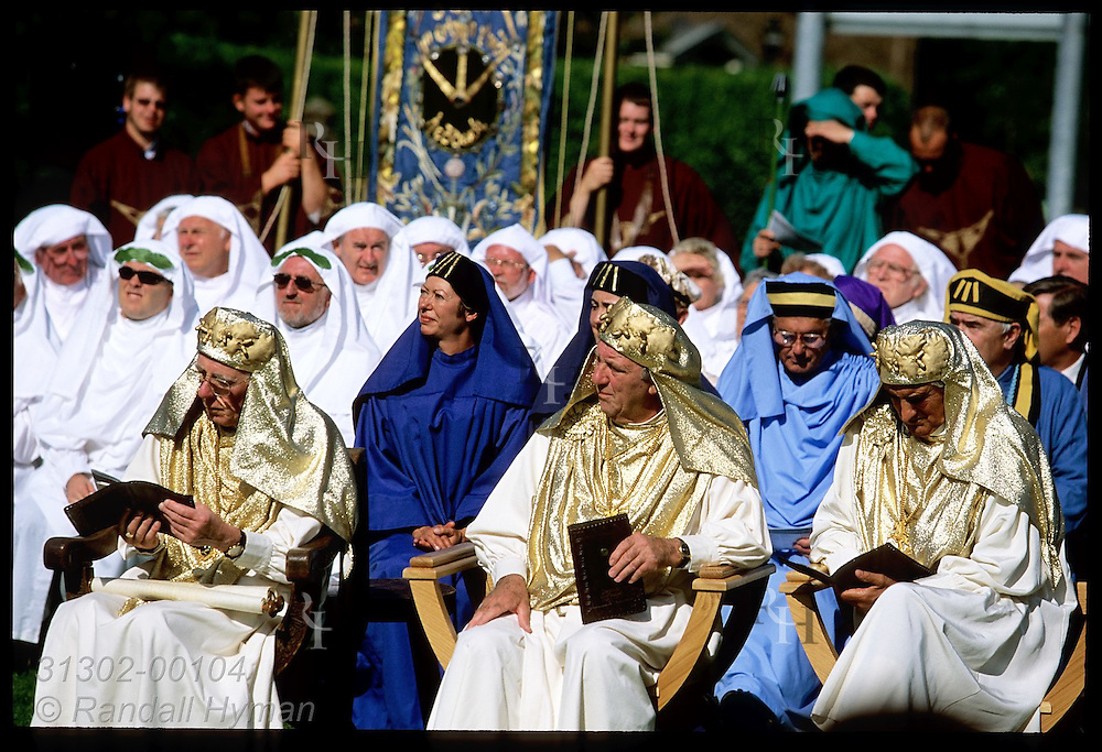Ex-archdruids and members of bard society (Gorsedd of Bards) sit at National Eisteddfod coronation; Welshpool, Wales.