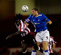 Photo: Jed Wee.<br /> Sheffield United v Birmingham City. Carling Cup. 24/10/2006.<br /> <br /> Birmingham's Martin Taylor (R) beats Sheffield United's Ade Akinbiyi to the ball.