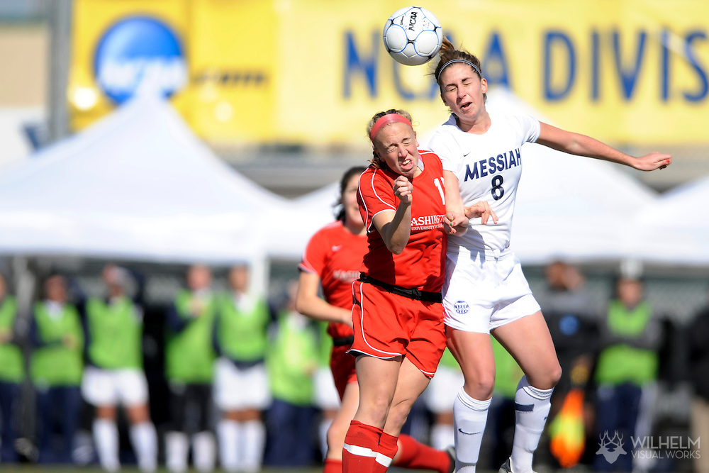 05 DEC 2009:  Katlyn Musser (8) of Messiah College heads the ball over Emma Brown (12) of Washington University in St. Louis during the Division III Women's Soccer Championship held at Blossom Soccer Stadium hosted by Trinity University in San Antonio, TX.  Messiah defeated Washington 1-0 for the national title.  © Brett Wilhelm