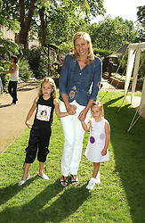 TANIA BRYER and her daughters, Left NATASHA MOUFARRIGE and right FRANCESCA MOUFARRIGE at a children's party to celebrate the launch of the new Baby Dior store in London - held in Eaton Square, London on 8th June 2005.<br />