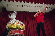 Milpitas Chamber of Commerce Ambassador Francisco Hernandez Jr. calls out the bids during the live auction during the Milpitas Chamber of Commerce Crab Feed at Napredak Hall in San Jose, California, on March 6, 2015. (Stan Olszewski/SOSKIphoto)