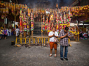 27 SEPTEMBER 2014 - BANGKOK, THAILAND: People pray in front of the temple during the celebration of the Vegetarian Festival at the Chow Su Kong Shrine in Talat Noi, a Chinese enclave in Bangkok. The Vegetarian Festival is celebrated throughout Thailand. It is the Thai version of the The Nine Emperor Gods Festival, a nine-day Taoist celebration beginning on the eve of 9th lunar month of the Chinese calendar. During a period of nine days, those who are participating in the festival dress all in white and abstain from eating meat, poultry, seafood, and dairy products. Vendors and proprietors of restaurants indicate that vegetarian food is for sale by putting a yellow flag out with Thai characters for meatless written on it in red.    PHOTO BY JACK KURTZ