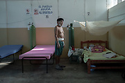 Demetrio Mera is an elder of the Cacataibo ethnic people also from the Rainforest. He has the Covid-19 symptoms and can barely breath. He is being treated by the Matico Command, an organization of traditional nurses founded by the Shipibo-Konibo people.