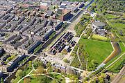 Nederland, Noord-Holland, Amsterdam, 09-04-2014;<br /> Cultuurpark Westergasfabriek en Westerpark op het voormalige  Westergasterrein, langs de Haarlemmertrekvaart en de Haarlemmerweg. Links van het kanaal woonwijk de multiculturele Staatsliedenbuurt en bij oude watertoren de nieuwbouw Waterwijk.  Volkstuinencomplex Nut&Genoegen rechtsboven.<br /> <br /> Culture park Westergasfabriek and the Westerpark on the former Westergasterrein (gasworks), and residential district on the other side of the channel.<br /> luchtfoto (toeslag op standard tarieven);<br /> aerial photo (additional fee required);<br /> copyright foto/photo Siebe Swart
