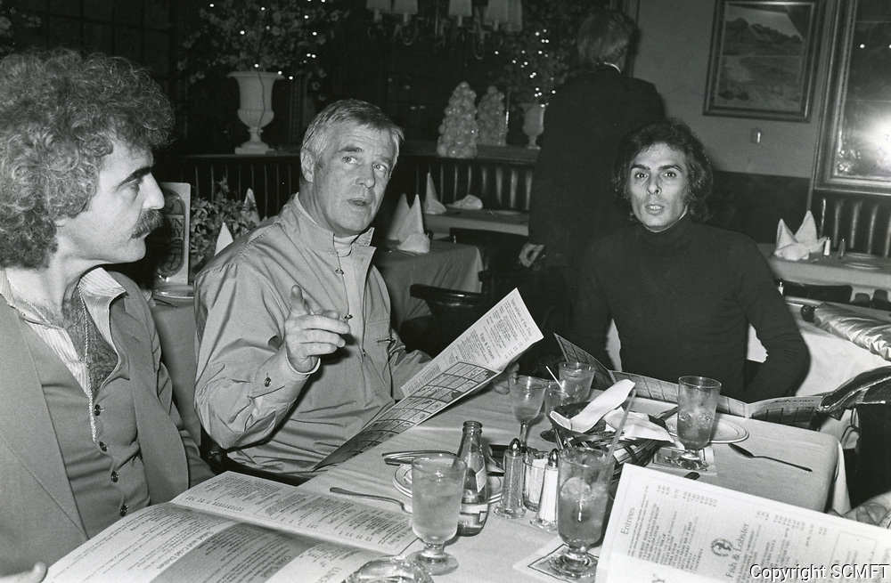 1977 Actor George Peppard having dinner at the Brown Derby Restaurant on Vine St. in Hollywood
