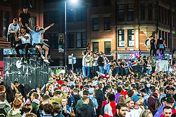 © Licensed to London News Pictures . 07/07/2021. Manchester, UK. Hundreds of fans and revellers pack in to Stevenson Square in Manchester City Centre as celebrations take place following Englands victory over Denmark in the European Cup secured the team a place in the cup final . Photo credit: Joel Goodman/LNP