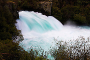 The Waikato River drops 11 meters (36 feet) at Huka Falls near Taupo, New Zealand. Huka Falls is the largest waterfall along the river.