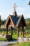 "A wood pavillion marks the entry to Heddal stave church, Norway's largest stave church. This triple nave stave church, which some call ""a Gothic cathedral in wood,"" was built in the early 13th century and restored in 1849-1851 and the 1950s. Heddal stavkirke is in Notodden municipality, Telemark County, Norway."
