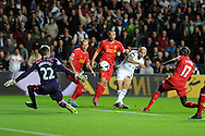 Swansea city's Jonjo Shelvey shoots and scores the 1st goal. Barclays Premier league match, Swansea city v Liverpool at the Liberty Stadium in Swansea, South Wales on Monday 16th Sept 2013. pic by Andrew Orchard, Andrew Orchard sports photography,