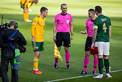 DUBLIN, REPUBLIC OF IRELAND - Sunday, October 11, 2020: Wales' captain Aaron Ramsey (L) and Republic of Ireland's captain Shane Duffy (R) with referee Tasos Sidiropoulos during the UEFA Nations League Group Stage League B Group 4 match between Republic of Ireland and Wales at the Aviva Stadium. The game ended in a 0-0 draw. (Pic by David Rawcliffe/Propaganda)
