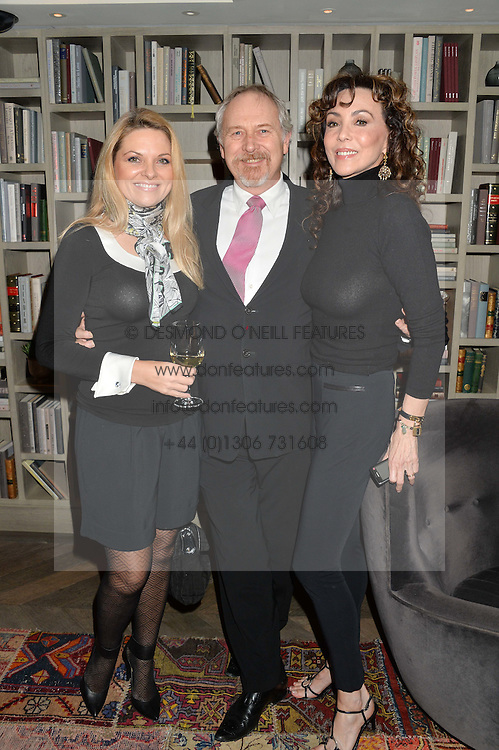 Left to right,  GINA COWNE, MARK COWNE and MARIE HELVIN at a reception to celebrate the publication of The Shadow of The Crescent Moon by Fatima Bhutto at the Belgraves Hotel, 20 Chesham Place, London, on 2nd December 2013.