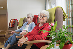 Two senior women at rest home