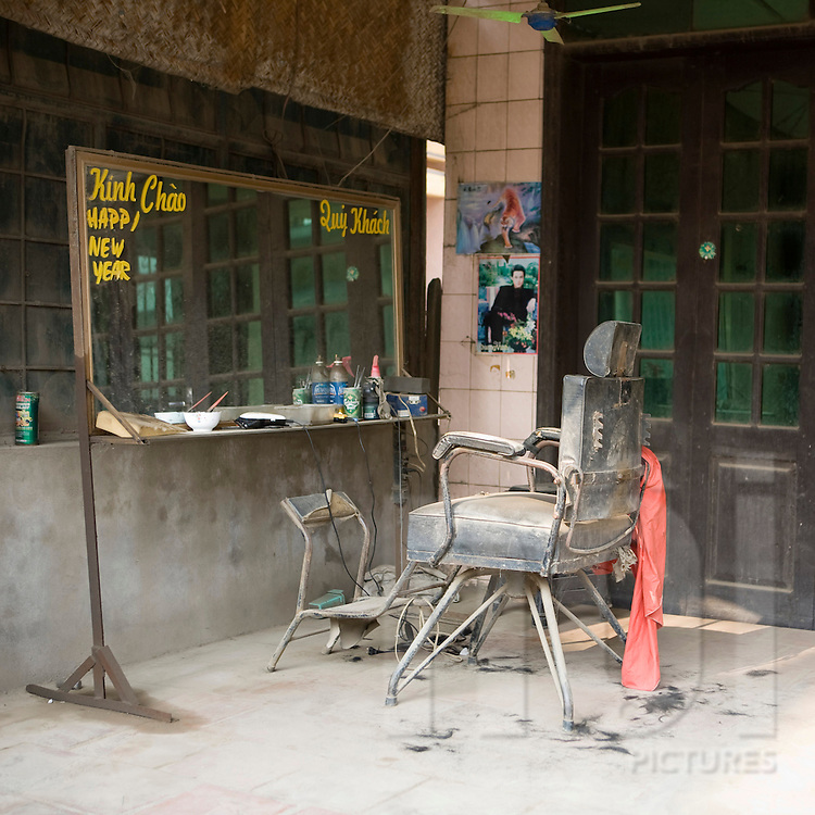 Color film photograph of an empty barber shop in in Da Hoi steel production craft village, Hanoi outskirts, Vietnam, Southeast Asia