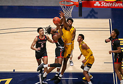 Jan 25, 2021; Morgantown, West Virginia, USA; Texas Tech Red Raiders forward Tyreek Smith (10) shoots in the lane against West Virginia Mountaineers forward Derek Culver (1) during the first half at WVU Coliseum. Mandatory Credit: Ben Queen-USA TODAY Sports