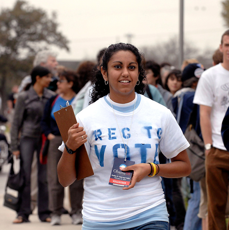 Austin, Texas: February 23, 2007: African-American Student voter registration volunteers at a U.S. Senator Barack Obama (D-Illinois) rally, his second major rally after announcing his candidacy for President of the United States last month. Obama spoke through a slight drizzle to a crowd of about 17,000 at Austin's Town Lake.   ©Bob Daemmrich /
