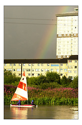 A rainbow falls on a Topper sailing on the Forth and Clyde Canal in Central Glasgow at the start of the Sailing in the City Project by RYA Scotland.