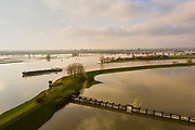 Nederland, Gelderland, Gemeente Arnhem, 04-002-2021; Hondsbroeksche Pleij met in de achtergrond de IJsselkop (splitsing van het Pannerdensch Kanaal in Neder-Rijn en IJssel). In de uiterwaarden van de Hondsbroeksche Pleij bij Westervoort het regelwerk wat bij hoogwater het water over beide riviertakken verdeelt. Het hoogwater komt via de Rijn vanuit Duitsland ten gevolge van overvloedige regenval en smeltwater bij de bovenloop van de rivier de Rijn. <br /> Hondsbroeksche Pleij with the IJsselkop in the background (where the Pannerdensch Canal of the Rhine bifurcates in the rivers in Neder-Rijn and IJssel). In the floodplains of the Hondsbroeksche Pleij near Westervoort, the regulating work that divides the water over both river branches during high water. The high water comes from Germany via the Rhine as a result of abundant rainfall and meltwater at the upper reaches of the river Rhine.<br /> <br /> drone-opname (luchtopname, toeslag op standaard tarieven);<br /> drone recording (aerial, additional fee required);<br /> copyright foto/photo Siebe Swart
