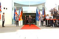 20 SEP 2003, BERLIN/GERMANY:<br /> Gerhard Schroeder, SPD, Bundeskanzler, kommt aus dem Haupteingang um seine Gaeste T ony B lair, Premierminister Gross Britannien und J acques Chirac, Praesident Frankreich, vor einem Treffen zu einem Gipfelgespraech zu empfangen, Ehrenhof, Bundeskanzleramt <br /> IMAGE: 20030920-01-001<br /> KEYWORDS: Gerhard Schröder, Gipfel, summit, Eintreffen, wartet, warten, Kamera, Camera, Fotograf, Fotografen, photographer, Gast, Gäste, Journalist, Journalisten, auf dem Weg