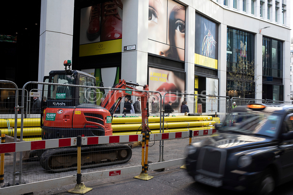 Giant advertising face with full lips and eyes looking down on the people passing below on Fenchurch Street in the City of London on 28th January 2020 in London, England, United Kingdom. The atmosphere is one of being watched and of Big Brother watching you.