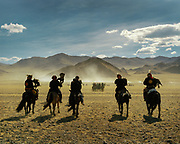 Some eagle hunters ride for days to partake in this yearly competition.<br /> <br /> Eagle Hunting festival in Western Mongolia, in the province of Bayan Olgii. Mongolian and Kazak eagle hunters come to compete for 2 days at this yearly gathering.