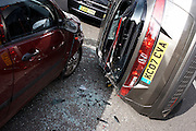 A Honda Civic car involved in a high-speed police pursuit has crashed and somersaulted into parked cars on a quiet residential street in Herne Hill, South London England. Facing the opposite way from it's original direction of travel, its driver occupant was taken to hospital with minor injuries.