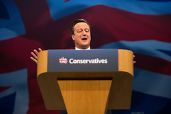 © Licensed to London News Pictures . 07/10/2015 . Manchester , UK . Prime Minister , DAVID CAMERON , delivers the leader's speech to the conference . The Conservative Party Conference at the Manchester Central Convention Centre . Photo credit : Joel Goodman/LNP