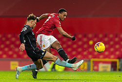 MANCHESTER, ENGLAND - Friday, January 1, 2020: Manchester United's Anthony Martial sees his shot saved during the New Year's Day FA Premier League match between Manchester United FC and Aston Villa FC at Old Trafford. The game was played behind closed doors due to the UK government putting Greater Manchester in Tier 4: Stay at Home during the Coronavirus COVID-19 Pandemic. (Pic by David Rawcliffe/Propaganda)