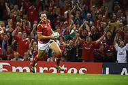 Cory Allen of Wales  runs in to score a try. Rugby World Cup 2015 pool A match, Wales v Uruguay at the Millennium Stadium in Cardiff, South Wales  on Sunday 20th September 2015.<br /> pic by  Andrew Orchard, Andrew Orchard sports photography.