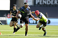 Josh Matavesi of the Ospreys looks to offload a pass while Leinster's Josh Van Der Flier (l) tackles. Guinness Pro12 rugby match, Ospreys v Leinster Rugby at the Liberty Stadium in Swansea, South Wales on Saturday 8th April 2017. <br /> pic by Andrew Orchard, Andrew Orchard sports photography.