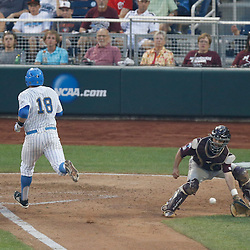 Jun 25, 2013; Omaha, NE, USA; UCLA Bruins second baseman Cody Regis (18) scores against Mississippi State Bulldogs catcher Nick Ammirati (right) during the fourth inning in game 2 of the College World Series finals at TD Ameritrade Park. Mandatory Credit: Derick E. Hingle-USA TODAY Sports
