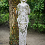 A statue, partly a male mermaid, in Brussels Park across from the Royal Palace of Brussels in central Brussels, Belgium.