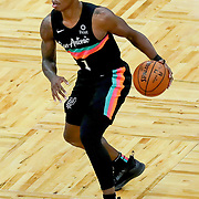 ORLANDO, FL - APRIL 12: Lonnie Walker IV #1 of the San Antonio Spurs controls the ball against the Orlando Magic at Amway Center on April 12, 2021 in Orlando, Florida. NOTE TO USER: User expressly acknowledges and agrees that, by downloading and or using this photograph, User is consenting to the terms and conditions of the Getty Images License Agreement. (Photo by Alex Menendez/Getty Images)*** Local Caption *** Lonnie Walker IV