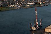 Views of Yokkaichi port, including international shipping and oil refinery.