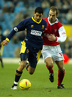 Photo. Chris Ratcliffe<br />Wimbledon vRotherham . FA Nationwide 1st Division. 06/12/2003<br />jobi mcanuff of wimbledon gets away from paul warne of rotherham