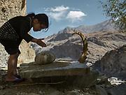 Gulandon (daughter of Zebo) praying at the shrine (astone) from Khojayi Khizr. Savnob village.