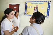 Sabin Institute senior program officer Karen Palacio, (left) listens to health workers tell her about deworming activities at the health center in San Esteban, Honduras on Thursday April 25, 2013.