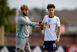 NEWPORT, WALES - Friday, September 3, 2021: Wales' goalkeeper Tyler Evans (L) and England's Kaide Gordon during an International Friendly Challenge match between Wales Under-18's and England Under-18's at Spytty Park. (Pic by David Rawcliffe/Propaganda)