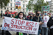 Activists from HS2 Rebellion, an umbrella campaign group comprising longstanding campaigners against the HS2 high-speed rail link as well as Extinction Rebellion activists, attend a protest rally in Parliament Square on 4 September 2020 in London, United Kingdom. The rally, and a later protest action at the Department of Transport during which activists glued themselves to the doors and pavement outside and sprayed fake blood around the entrance, coincided with an announcement by HS2 Ltd that construction of the controversial £106bn high-speed rail link will now commence.