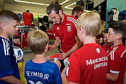 CARDIFF, WALES - Thursday, June 2, 2016: Wales' Gareth Bale signs autographs during a visit to a JD Sports store in Llantrisant. (Pic by Ian Cook/Propaganda)