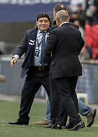 Football - 2017 / 2018 Premier League - Tottenham Hotspur vs. Liverpool<br /> <br /> Diego Maradona greets Ossie Ardiles at half time as he is introduced at Wembley Stadium.<br /> <br /> COLORSPORT/DANIEL BEARHAM