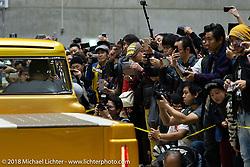 The cameras go crazy for the Grand Entry of hot rods and custom bikes into the 27th Annual Mooneyes Yokohama Hot Rod Custom Show 2018. Yokohama, Japan. Sunday, December 2, 2018. Photography ©2018 Michael Lichter.