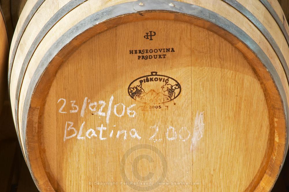 Oak barrel with chalked text saying Blatina Hercegovina Produkt winery, Citluk, near Mostar. Federation Bosne i Hercegovine. Bosnia Herzegovina, Europe.