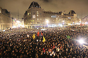 """Huge crowds are drawn to a massive public demonstration took place in Place de la Republique, in central Paris, France; the evening after armed gunmen attacked the offices of Charlie Hebdo, killing twelve people, including the editor and celebrated cartoonists; four more are in critical condition. It is the dealiest terror attack in France for over fifty years. Charlie Hebdo is a satirical publication well known for its political cartoons. <br /><br />As a solidarity actions with the deaths at Charlie Hebdo many placards read """"Je suis Charlie"""" translating as """"I am Charlie (Hebdo)"""". Demonstrators held aloft pens, brushes and crayons, symbolizing the profession of journalists and cartoonists who were killed. Many pens were placed in a shrine with candles in the square"""