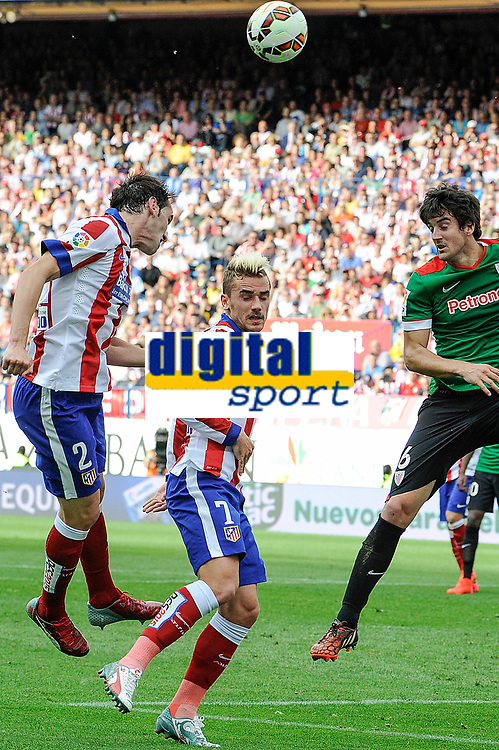 Atletico de Madrid´s Diego Godin and Antoine Griezmann and Athletic Club´s Mikel San Jose during 2014-15 La Liga match between Atletico de Madrid and Athletic Club at Vicente Calderon stadium in Madrid, Spain. May 02, 2015. (ALTERPHOTOS/Luis Fernandez)