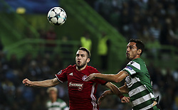 November 22, 2017 - Lisbon, Portugal - Olympiakos's forward Kostas Fortounis (L) vies with Sporting's defender Andre Pinto during the Champions League  football match between Sporting CP and Olympiacos at Jose Alvalade  Stadium in Lisbon on November 22, 2017. NURPHOTO/CARLOS COSTA. (Credit Image: © Carlos Costa/NurPhoto via ZUMA Press)