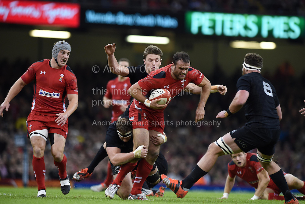 Jamie Roberts of Wales is tackled by NZ's Brodie Retallick. Dove Men Series 2014, Wales v New Zealand , autumn international rugby match at the Millennium Stadium in Cardiff, South Wales on Saturday 22nd November 2014<br /> pic by Andrew Orchard, Andrew Orchard sports photography.