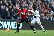 Paul Pogba of Manchester Utd (l) holds back Ki Sung-Yueng of Swansea city .Premier league match, Swansea city v Manchester Utd at the Liberty Stadium in Swansea, South Wales on Sunday 6th November 2016.<br /> pic by  Andrew Orchard, Andrew Orchard sports photography.